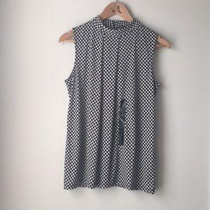 Black and white sleeveless top